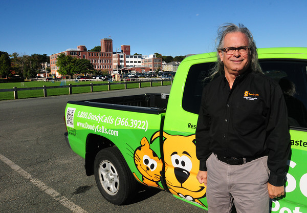 Newburyport: Joe Gliottone of Doody Calls pet waste removal. Bryan Eaton/Staff Photo