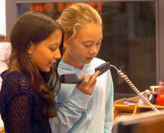 Salisbury: Sara Burd, left, and Rylee Lucia make the morning announcements and lead the Pledge of Allegiance at the beginng of the school day at Salisbury Elementary School on Tuesday. Children take turns doing the announcement, each team doing it for a week. Bryan Eaton/Staff Photo
