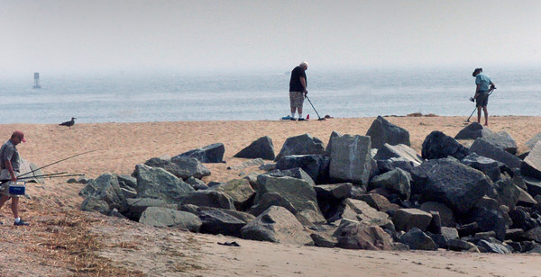 Salisbury: Fisherman and men with metal detectors were all in the business of luck Thursday at Salisbury Beach State Reservation. Bryan Eaton/Staff Photo