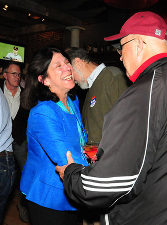 Newburyport: Newburyport City Council president Thomas O'Brien congratulates Mayor Donna Holaday in her first place showing at Oregano's Restuarant. Bryan Eaton/Staff Photo