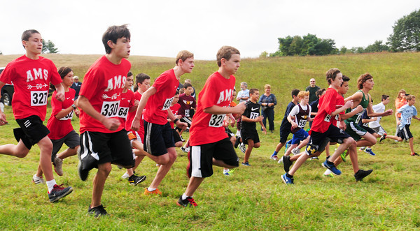 """Amesbury: Boys middle school runners compete in one of the races at the """"Miles For Mike"""" Cross-Country Festival at Woodsom Farm in Amesbury, renamed for Amesbury High cross country coach Mike Farmer who passed away this year. Bryan Eaton/Staff Photo"""