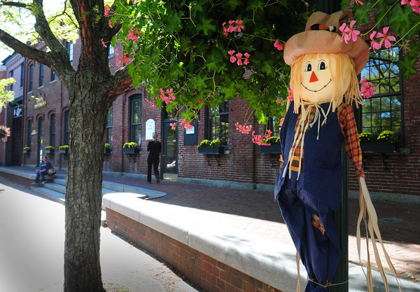 Amesbury: A scarecrow is planted in Amesbury's Market Square where much of this Saturday's Fall Festival will take place. Bryan Eaton/Staff Photo