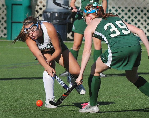 Amesbury: Pentucket's Liza Brackbill moves the ball past Manchester-Essex player Maddy Dahlin. Bryan Eaton/Staff Photo