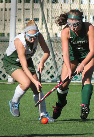 Amesbury: Pentucket's Colleen Mulholland, left, goes up against a Manchester-Essex player at the Amesbury Sports Park. Bryan Eaton/Staff Photo