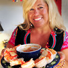 Newburyport: Lisa Summerville with her jumbo shrimp cooked in a flavorful broth. Bryan Eaton/Staff Photo