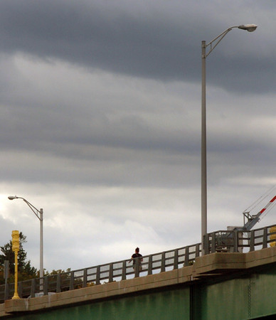 Newburyport: A pedestrian walks over the Gillis Bridge under some dark clouds Wednesday afternoon, though the forecast was for sun. Hopefully it will return today and into the weekend. Bryan Eaton/Staff Photo