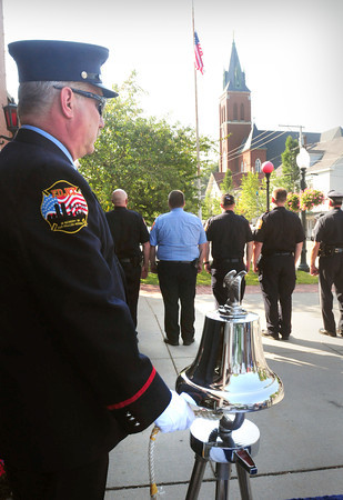 Amesbury: Amesbury firefighter James Nolan rings a bell in honor of those who perished in the 911 terrorist attacks 12 years ago, at a ceremony in front of the station yesterday. Bryan Eaton/Staff Photo