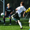 BRYAN EATON/ Staff Photo. The ball goes wide on the Hamilton-Wenham net on a shot by Pentucket's Aidan McLellan.