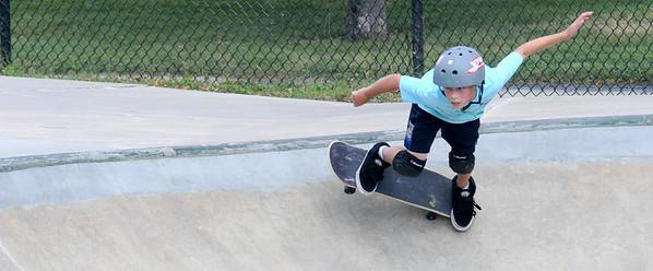 JIM VAIKNORAS/staff photo Lucas Gunther , 9, of Swampscott gets horizontal at the Newburyport skate park Monday afternoon.