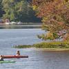 JIM VAIKNORAS/staff photo A pair of kayakers enjoy a warm Sunday afternoon on Lake Gardner in Amesbury.
