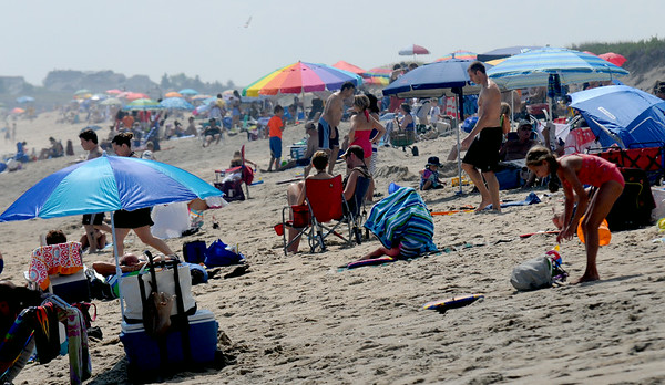 JIM VAIKNORAS/staff photo  Umbellas on Salisbury beach create a colorfull pallette on a hot sunny Labor Day.