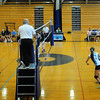 BRYAN EATON/ Staff Photo. Triton, right, takes on Lynnfield in volleyball Tuesday night in Byfield.