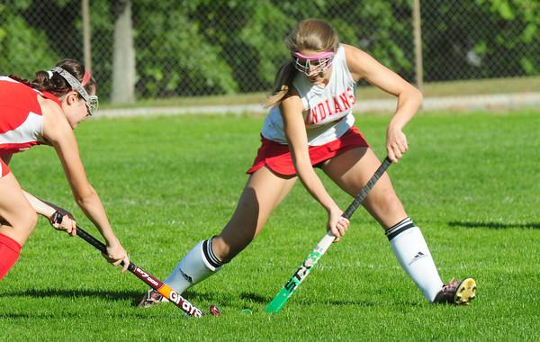 BRYAN EATON/ Staff Photo. Amesbury's Adrienne Harris tries to get the ball into Masconoment territory.