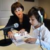 BRYAN EATON/Staff Photo. Lisa Keegan works with Richard Jenkins, 7, on his language and reading skills.