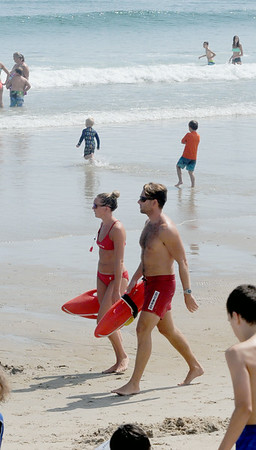 JIM VAIKNORAS/staff photo Head lifeguard Chelsea Foley and life guard supervisor CJ Kronin on Salisbury beach.