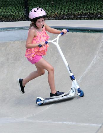 JIM VAIKNORAS/staff photo  Elise Gunther,6, of Swampscott does tricks on her razor scooter at the Newburyport skate park Monday.