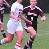BRYAN EATON/ Staff Photo. Amesbury's Amanda Martin moves past Whittier's Haley Coutore.