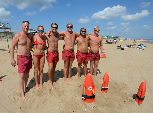JIM VAIKNORAS/staff photo Lifeguards Dave Torrisi, Chelsea Foley, CJ Kronin, Kris Reslow, Kevin Rauta, and Matt Rosene on Salisbury beach.