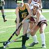 BRYAN EATON/Staff photo. Newburyport's Meghan Winn battles with a North Reading player.