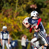 Jared Charney / Photo Amesbury's Cameron Leary forces Hamilton-Wenham's QB Billy Whelan to fumble on his throw, Saturday, October 15, 2016.