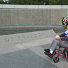 JIM VAIKNORAS/Staff photo World War 2 veteran Dexter Murray and his son in law Jonathan Pratt pause at the Rainbow Pool with a quote by President Truman at the WW2 Memorial in Washington DC Sunday.There are 4,048 gold stars; each one represents 100 American military deaths. That means that more than 400,000 soldiers, sailors, marines, airmen, and military personnel lost their lives or remain missing in action in World War II.