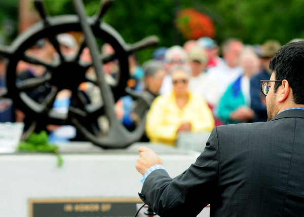 JIM VAIKNORAS/Staff photo Rabbi Bejamin Resnick speaks during the Relocation Ceremony for the Newburyport Fisherman's Memorial on the boardwalk on the Newburyport Waterfront Monday morning.