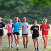 JIM VAIKNORAS/Staff photo Triton girls cross country team practice on Newman Rd in Newbury.
