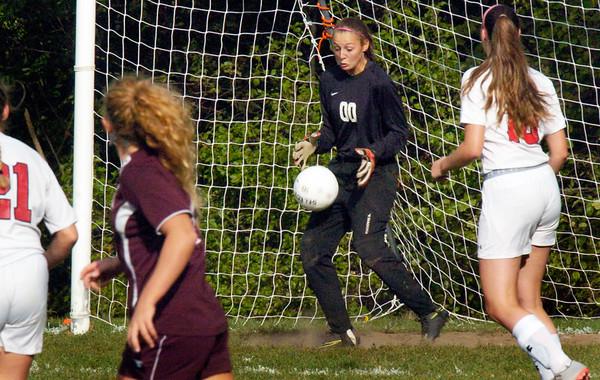 BRYAN EATON/Staff photo. Amesbury goalie makes a save.