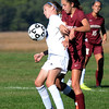 BRYAN EATON/Staff photo. A Triton player (20) and Newburyport's Margaret Cote vie for a loose ball.