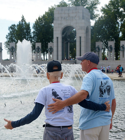 JIM VAIKNORAS/Staff photo World War 2 veteran Dexter Murray and his son in law Jonathan Pratt touor the WW2 Memorial in Washington DC Sunday they were part of a group  who flew from Boston for the day wit Honor Flight New England, a no profit out of Hooksett New Hampshire that provides flight to and tours of the capital.