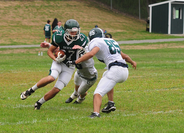 JIM VAIKNORAS/Staff photo Pentucket's Dylan Engelke takes on 2 tacklers as he returns a punt during their game against Canton Saturday at Pentucket. The Sachems lost the game 6-0.