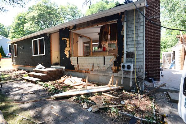 BRYAN EATON/Staff photo. The home halfway through demolition.