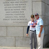 JIM VAIKNORAS/Staff photo World War 2 veteran Dexter Murray and his son in law Jonathan Pratt pose with a quote by President Truman at the WW2 Memorial in Washington DC Sunday they were part of a group  who flew from Boston for the day with Honor Flight New England, a no profit out of Hocksett New Hampshire that provide flght to and tours of the capital.