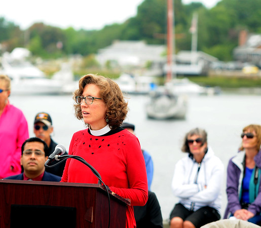 JIM VAIKNORAS/Staff photo Rev Martha Hubbard give the Homily during the Relocation Ceremony for the Newburyport Fisherman's Memorial on the boardwalk on the Newburyport Waterfront Monday morning.