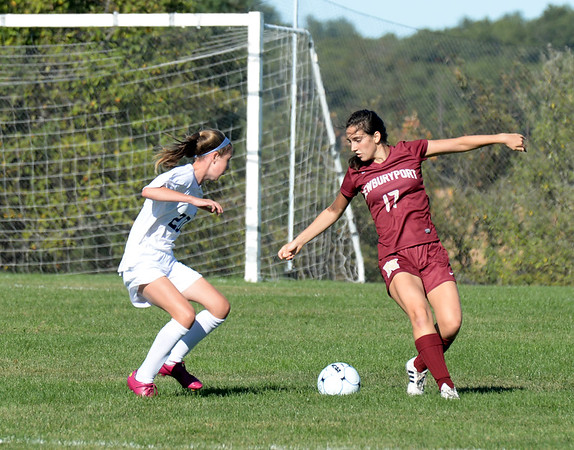 BRYAN EATON/Staff photo. Newburyport's Olivia Iannini with a Triton player.