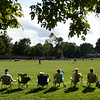 BRYAN EATON/Staff photo. Spectators catch late afternoon sun watching the Pentucket field hockey team host Newburyport.
