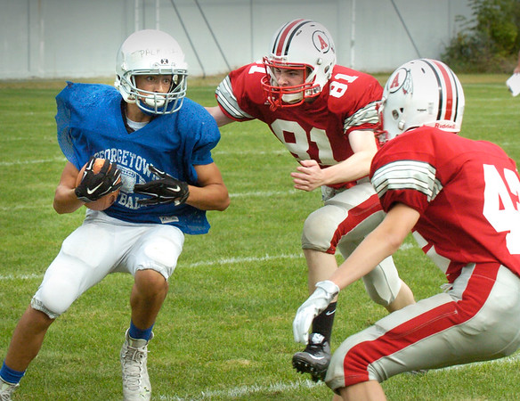 BRYAN EATON/Staff photo. Amesbury defenders move in on Georgetown's Carmine Palmisano.