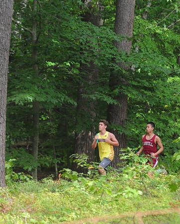 JIM VAIKNORAS/Staff photo Runners head throug the woods at Maudsay during the Newburyport Clipper relays Saturday morning.