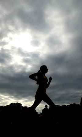 JIM VAIKNORAS/Staff photo A runner makes her way to the finish line at the Clipper Relay Saturday at Maudslay in Newburyport.