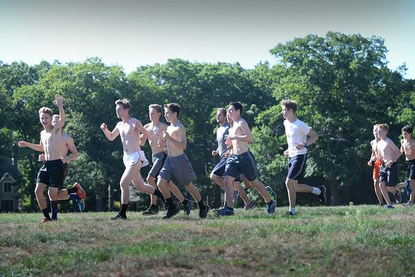 BRYAN EATON/Staff photo. The Newburyport High boys cross country team  head out on a run.