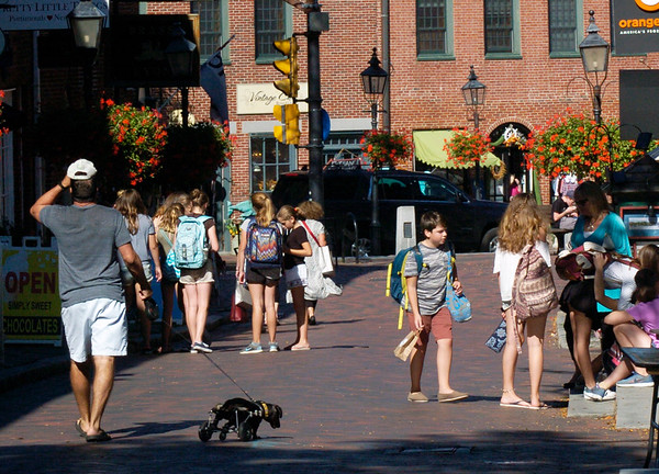 BRYAN EATON/Staff photo. With Newburyport Schools having early release yesterday and the first day of fall at least 10 degrees above normal, Inn Street in Newburyport was a busy place in the early afternoon.