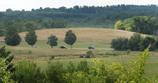 BRYAN EATON/Staff photo. A view of Woodsom Farm and Lion's Mouth Road from an open area on Whittier Hill.