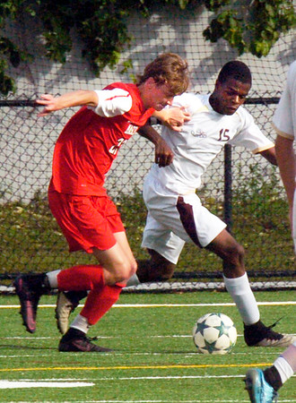 BRYAN EATON/Staff photo. Masco's Bryan Gilbert meets Newburyport's Nick Washington.