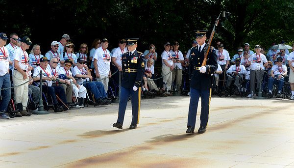 JIM VAIKNORAS/Staff photo Veterans from Honor Flight New England attend teh Changing of the Guard at the Tomb of the Unknown Soldier at Arlington Cemetery. As a salute to World War 2 vets the Captain of the Guard drags her heel slightly as she passes by.
