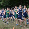 BRYAN EATON/Staff photo. Triton, Hamilton-Wenham and North Reading cross country runners begin the course.