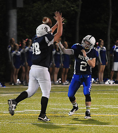 JIM VAIKNORAS/Staff photo  Georgetown's Tommy Long completes a pass under pressure against Matignon at Georgetown Friday night.