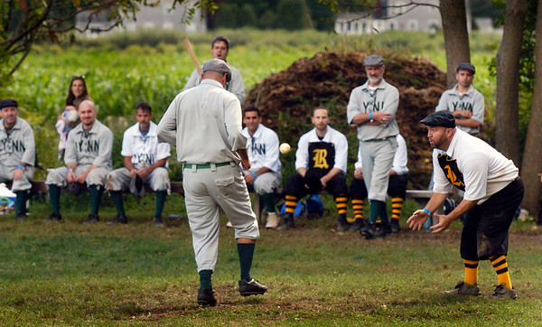 BRYAN EATON/Staff photo. Vintage baseball players representing Lynn and Portsmouth, N.H. entertained attendees the the American Music and Harvest Festival at the Spencer-Peirce-Little Farm on Saturday. The players don't use helmets or gloves as was the case in the early days of America's pastime.