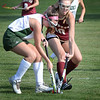 BRYAN EATON/Staff photo. Newburyport's Sky Harrington tries to get the ball from Pentucket's Caroline Cloutier.
