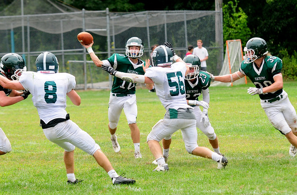 JIM VAIKNORAS/Staff photo Pentucket's Finn Graham looks downfield for a reciever during their game against Canton Saturday at Pentucket. The Sachems lost the game 6-0.