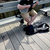 JIM VAIKNORAS/Staff photo Sam Doling of Columbus Ohio casts a shadow in the afternoon sunshine as he plays the banjo on the boardwalk in Newburyport Thursday afternoon.